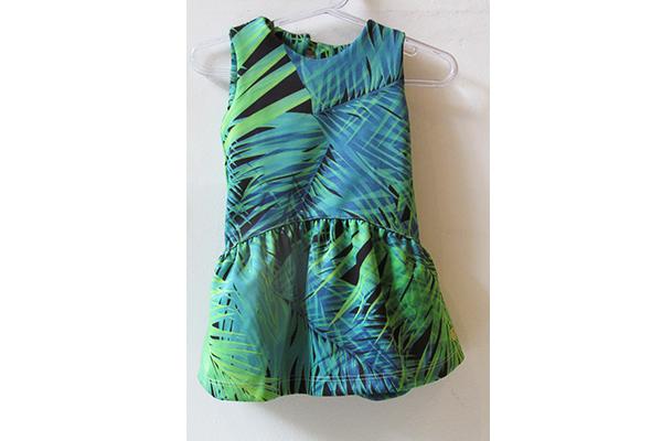 Vestido verde infantil: 99 reais, na Paola da Vinci (Rua Oscar Freire, 958, Jardins)