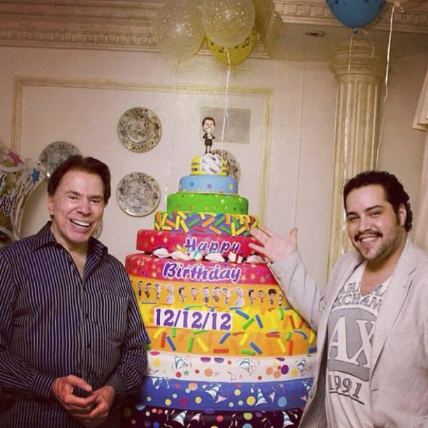 O apresentador e Tiago Abravanel durante comemoração de seu aniversário em 2012