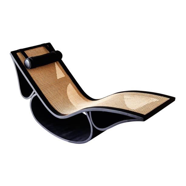 Chaise Rio (1978) , de Oscar Niemeyer, feito em madeira, plalha e couro naturais: 50 000 reais