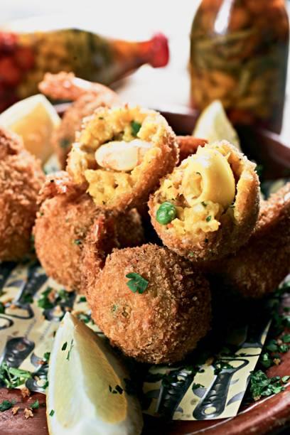 Bolinhos de paella: porção com oito unidades