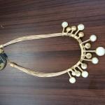 Colar feito com palha de buriti: 60 reais