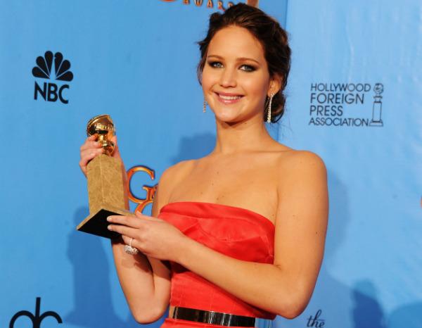 Jennifer Lawrence ganhou o Globo de Ouro no ano passado por O Labo Bom da Vida e concorre hoje por Trapaça
