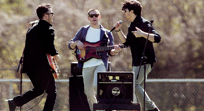 **EXCLUSIVE** Ahead of their Latin American tour, The Jonas Brothers, (Nick, Joe and Kevin Jonas), shoot a music video on a high school football field in Louisiana