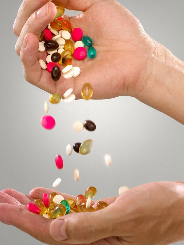 Person with pills and capsules
