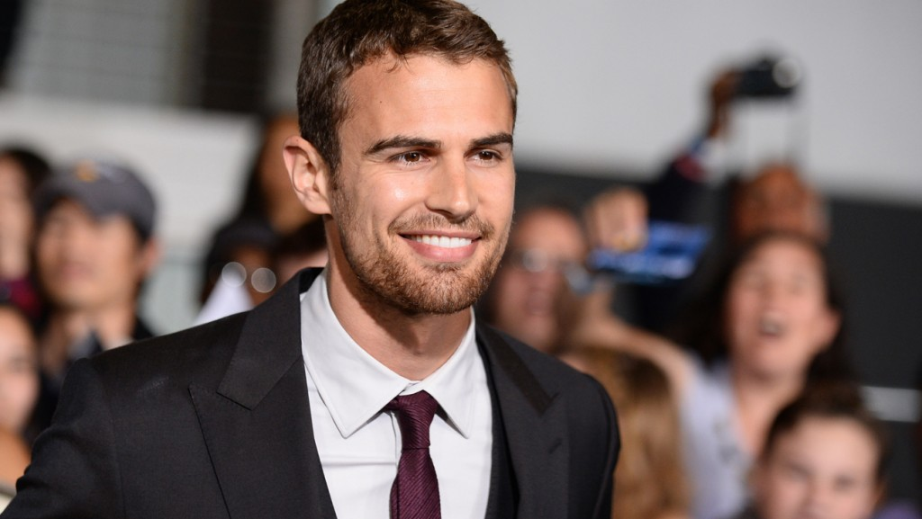 """Theo James arrives at the world premiere of """"Divergent"""" at the Westwood Regency Village Theater on Tuesday, March 18, 2014, in Los Angeles. (Photo by Jordan Strauss/Invision/AP)"""
