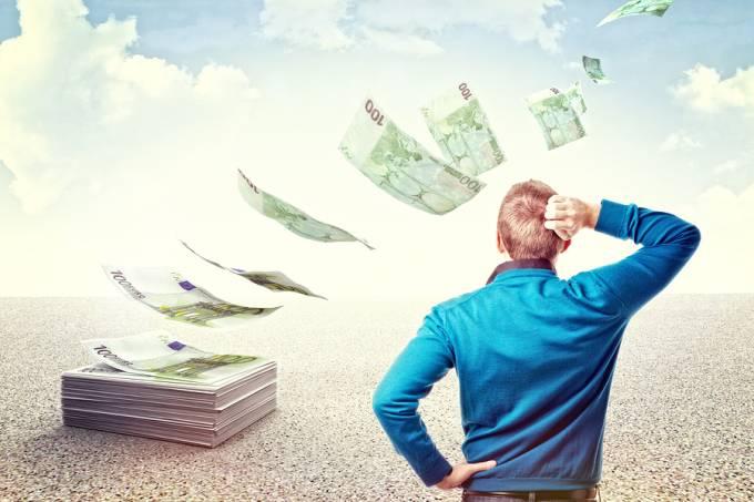bigstock-man-look-his-money-fly-away-456574751