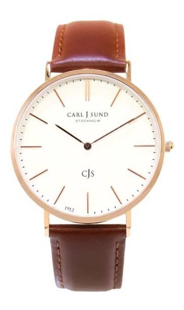Relógio analógico com pulseira de couro, R$ 850,00. Carl J Sund.