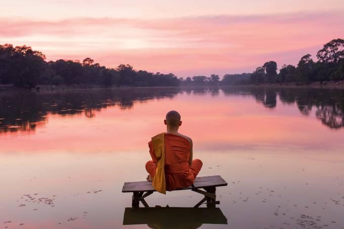 Cambodia, Angkor Wat, Buddhist Monk at sunset