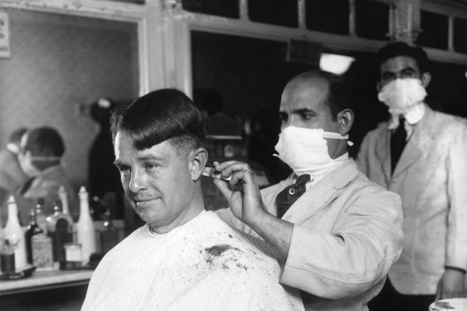 Man Getting Haircut from Barber Wearing Surgical Mask