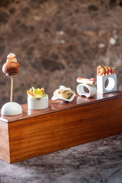 Bomba de vieira,a salada ceasar, a torta de cogumelo, o cannolo de foie gras, fígado de galinha e a espiral com carne