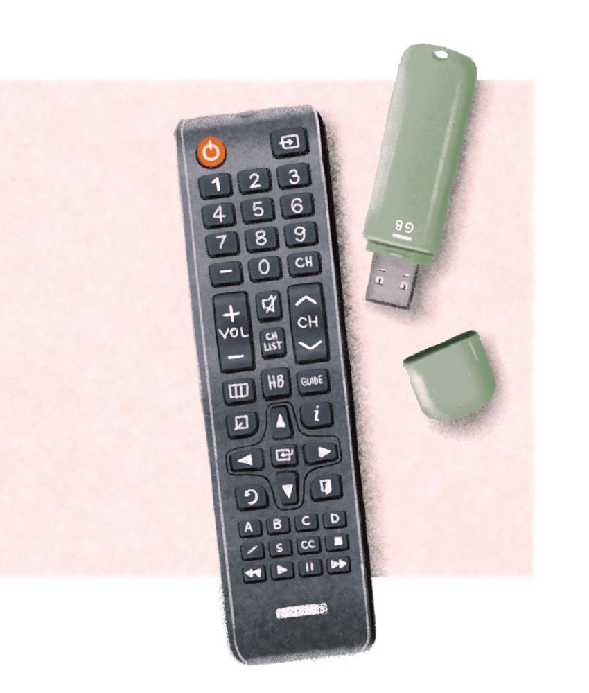 Um controle e um pen-drive sobre um pano rosa