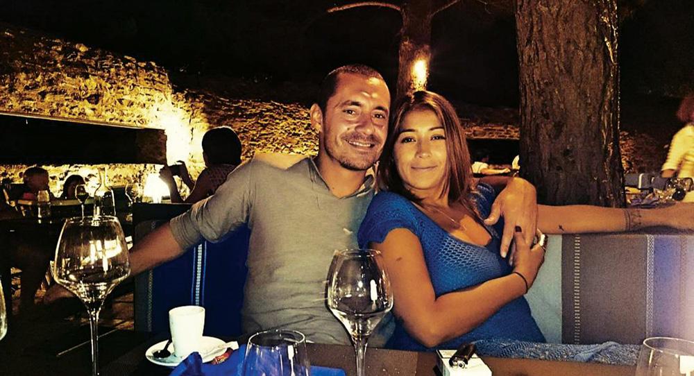 Thais e Rodrigo abraçados em restaurante