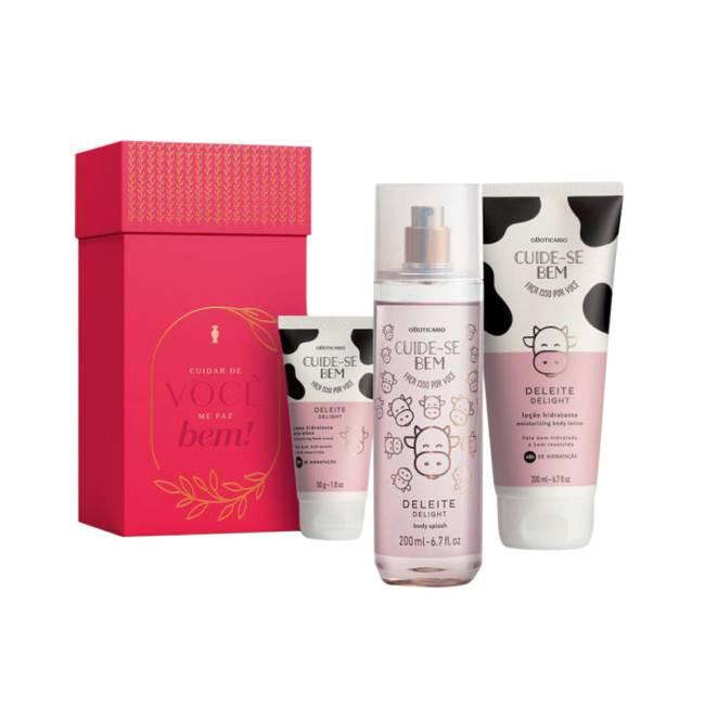 Montagem com caixa rosa para presente e loção hidratante, body splash e creme de mãos com estampa de vaca