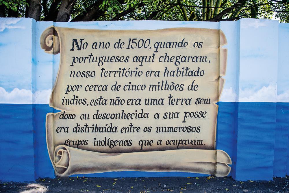 grafite de um texto que conta a história de origem do bairro