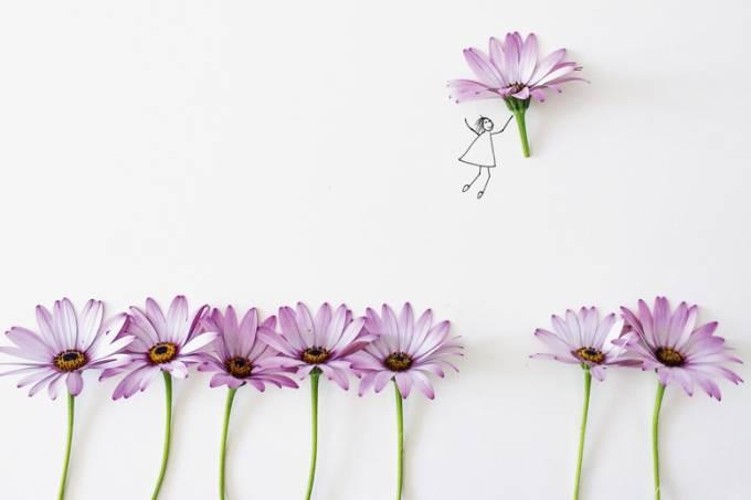 Conceptual girl picking flower