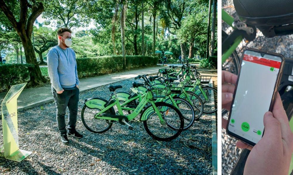 A imagem mostra Lucas em frente as bikes que podem ser alugadas e, à direita, há uma foto de seu celular aberto no aplicativo, com tela predominantemente branca.