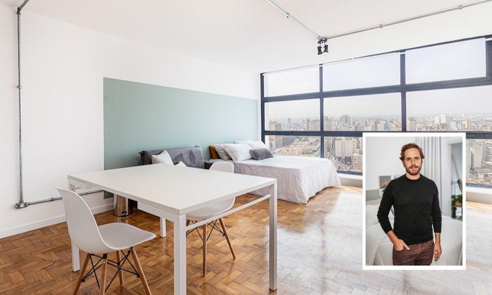 A imagem mostra um apartamento no Mirante do Vale, com uma sala e uma cama de casal ao fundo. Na montagem, há também uma foto de Steinbruch, com um a mão no bolso, olhando para a câmera
