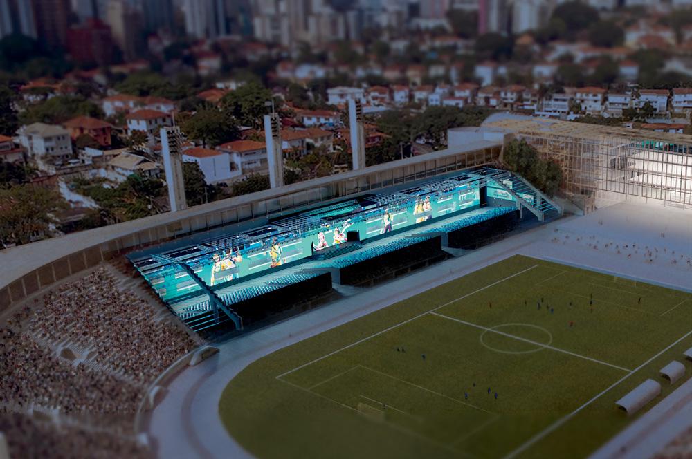 A imagem mostra um projeção da futura área em baixo da arquibancada do Pacaembu destinada para eventos esportivos virtuais. Há um extenso telão e três pequenas arquibancadas no espaço