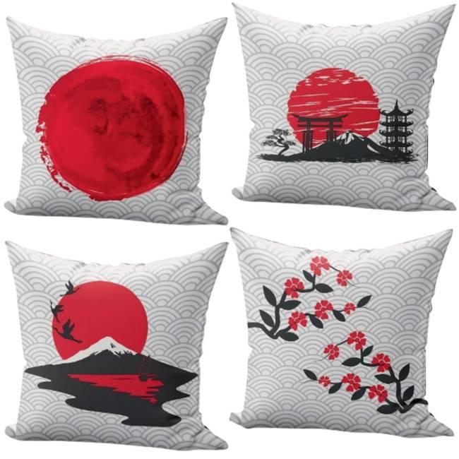 Quatro almofadas brancas com detalhes em vermelho e preto. Uma tem a bandeira do Japão, outra flores, outra o Monte Fuji e outra símbolos japoneses