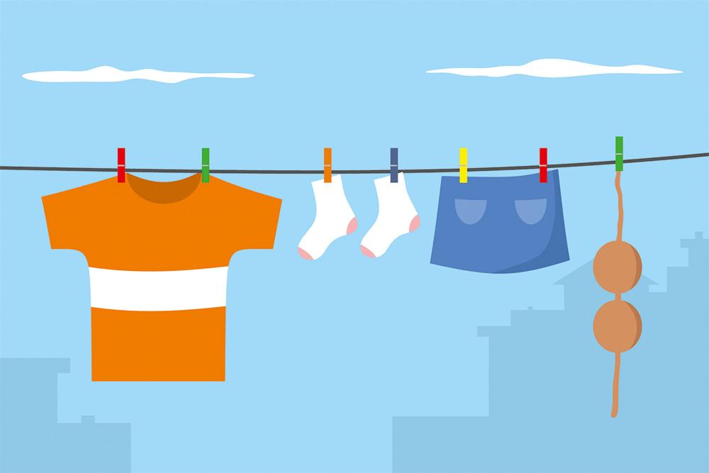 arte de roupas pregadas ao varal com o céu azul ao fundo