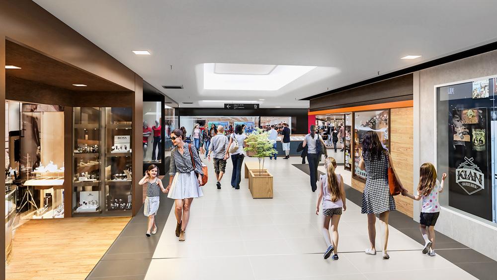 Um projeto de um shopping repaginado. Há pessoas caminhando e lojas ao redor