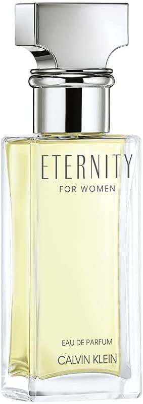 Frasco de perfume verde claro de vidro com o escrito