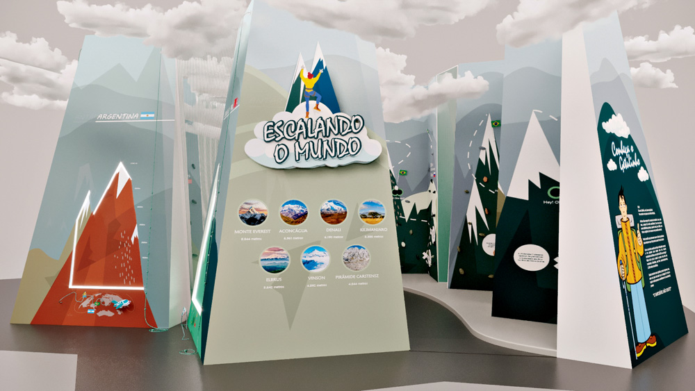 Em um espaço expositivo, há placas grandes, do chão ao teto, em formato triangular 3D, sobre montanhas, com imagens, gráficos e ilustrações