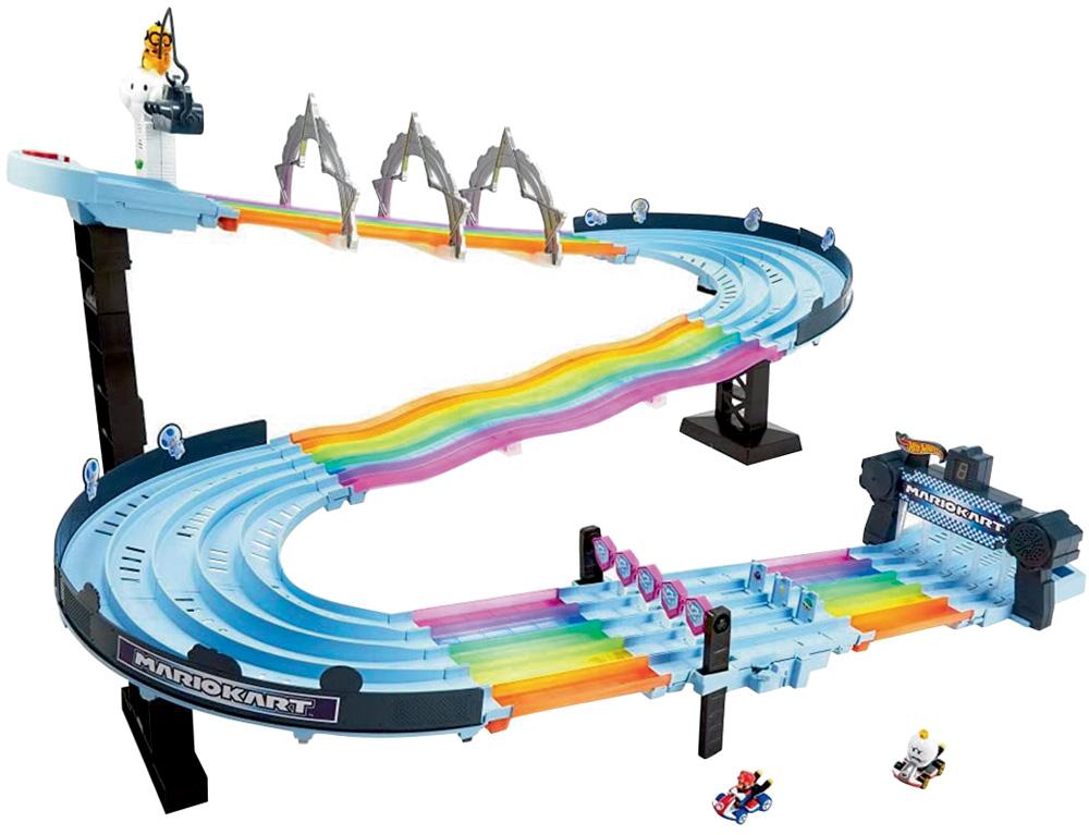Um brinquedo de uma pista de carrinhos grande, em azul claro com detalhes em arco-íris